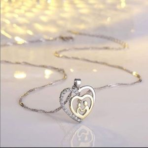 Jewelry - Sterling Silver/Gold Heart Mother/Child Necklace.